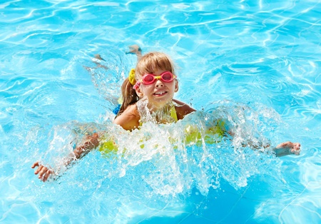 Little girl in swimming pool. Summer outdoor. Stock Photo - 13563218