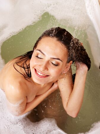 Young woman take shower in bathroom. photo