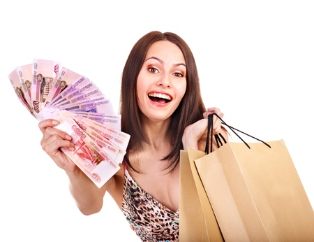 Woman with  money Russian rouble and shopping bag. Isolated. photo
