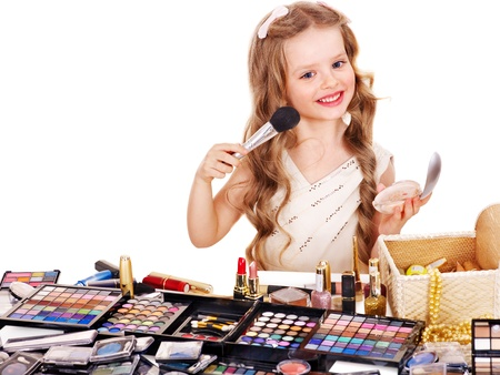 eyeshadow: Child cosmetics. Little girl applying make up. Stock Photo