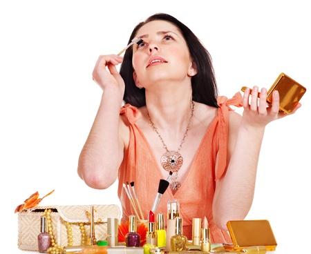 Girl applying makeup. Isolated. Stock Photo - 13563116