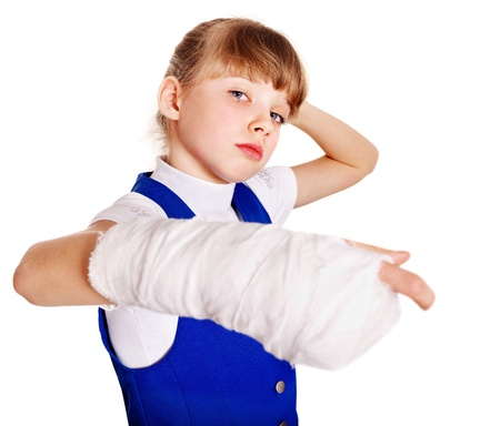 Child with broken arm. Isolated. photo