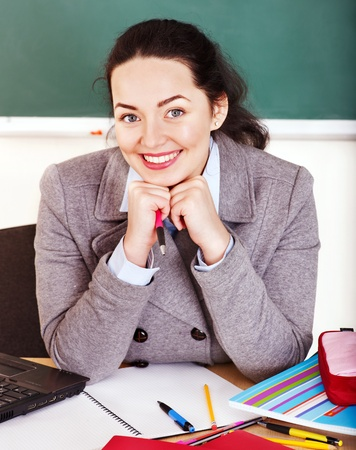 Young woman in classroom. Stock Photo - 13561893