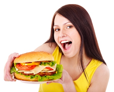 eat out: Woman holding hamburger. Isolated. Stock Photo