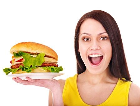 Woman holding hamburger. Isolated. Stock Photo - 13563107