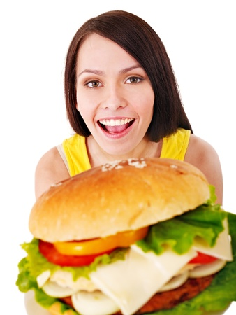 adult sandwich: Woman holding hamburger. Isolated. Stock Photo