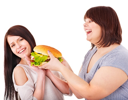 Women eating hamburger. Isolated. photo