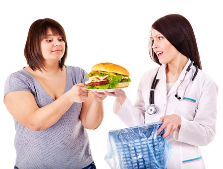 beefburger: Overweight woman with hamburger and doctor. Stock Photo