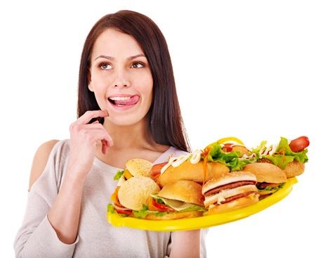 high calorie: Thin woman holding group hamburger.