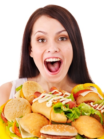 high calorie foods: Thin woman holding group hamburger.