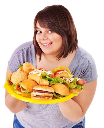 Overweight woman holding hamburger. Stock Photo - 13563072