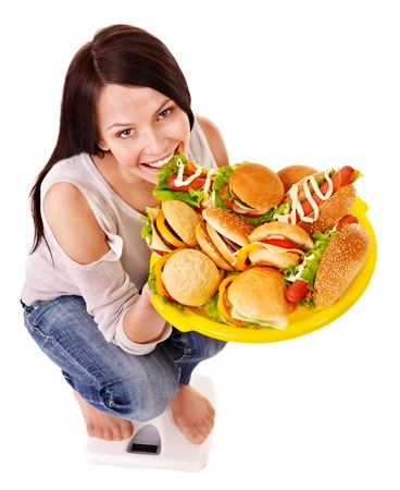 high calorie foods: Woman weight loss on scales. Isolated. Stock Photo