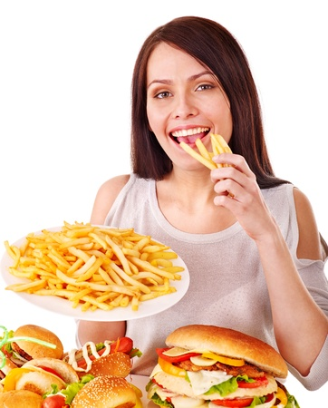 eating fast food: Woman eating fast food. Isolated.