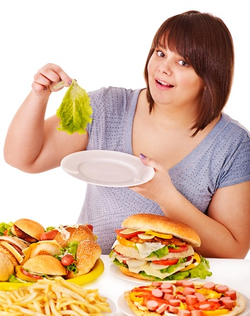 overweight people: Woman choosing between fruit and hamburger. Isolated.