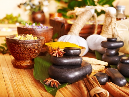 herbal massage ball: Spa still life with herbal ball and black stone.