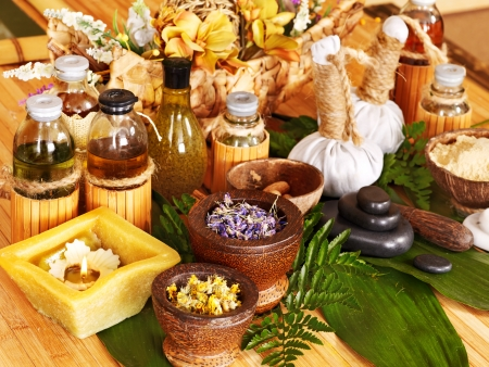 aromatherapy oils: Spa still life with leaf and massage stone. Stock Photo