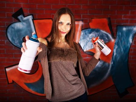 Woman with body art aganist graffiti brick wall. photo