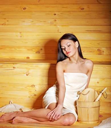 Young woman in sauna. Healthy lifestyle. photo