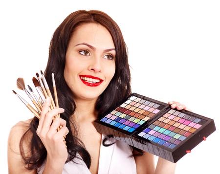 Girl holding eyeshadow and makeup brush.  Isolated. Stock Photo - 13563005