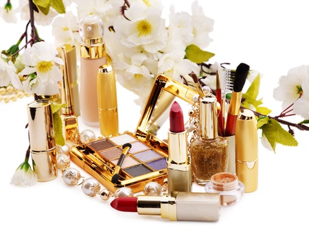 Group decorative cosmetics and flower. Isolated. photo