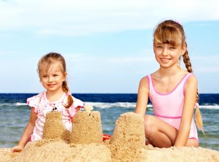 sandcastles: Children  playing summer outdoor on  beach.