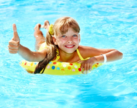 aquapark: Children sitting on inflatable ring in swimming pool. Stock Photo