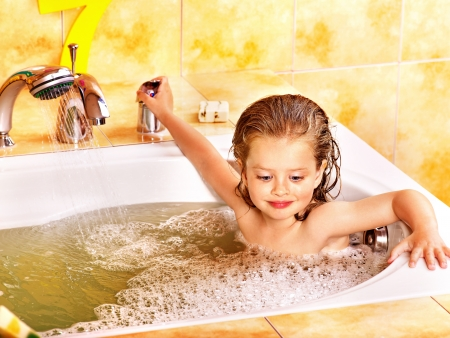 Child washing in bubble bath . Stock Photo - 13852091