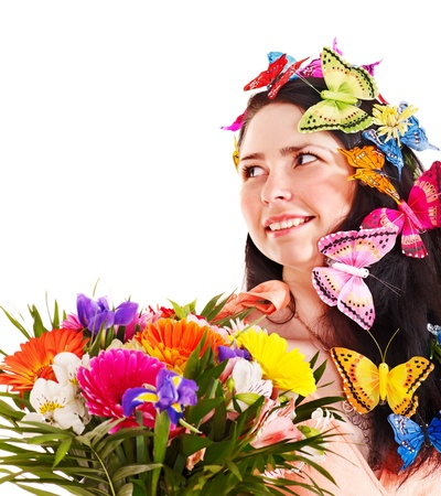 Girl in spring hairstyle with flower and butterfly. Isolated. Stock Photo - 13851973