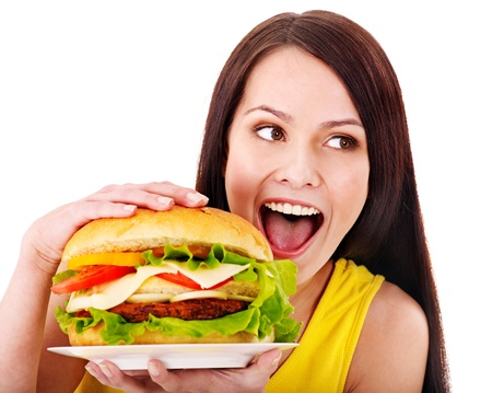 Woman holding hamburger. Isolated. Stock Photo - 13852004