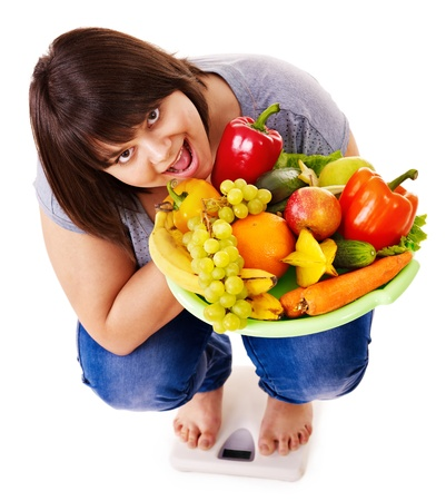 Woman weight loss on scales. Isolated. Stock Photo - 13851991