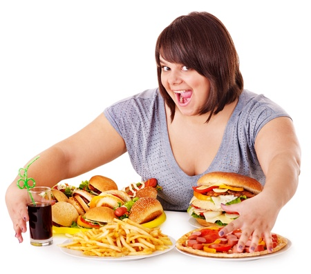 Overweight woman eating fast food. Stock Photo - 13852019