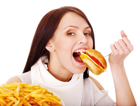 high calorie foods: Woman eating fast food. Isolated.