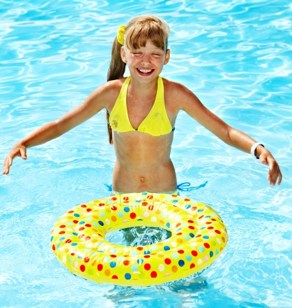 water wings: Little girl in swimming pool. Summer outdoor.
