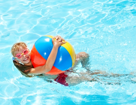 child ball: Little girl  swimming in pool. Stock Photo