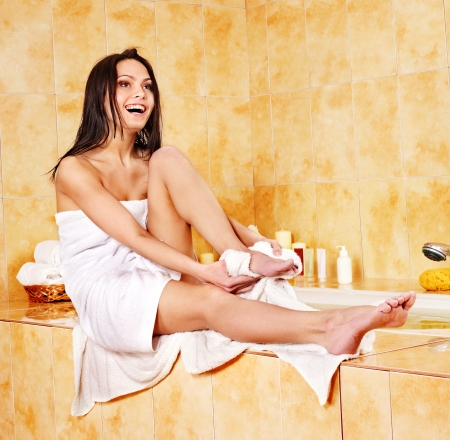bathrobes: Woman drying towel in bathroom.