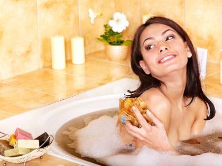 Yong woman bathing in bathroom Stock Photo - 14084639