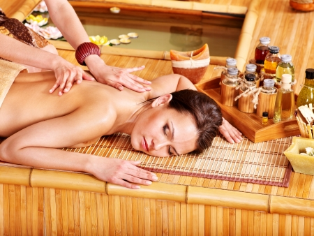 thai massage: Young woman getting massage in  spa. Stock Photo