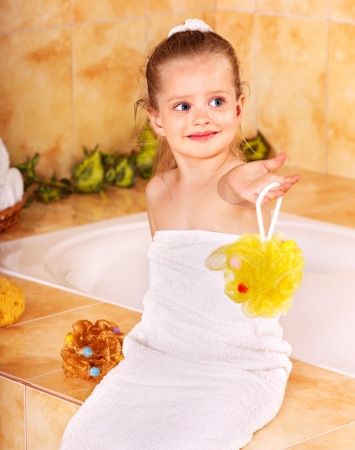 Little girl bathing in bubble bath . photo