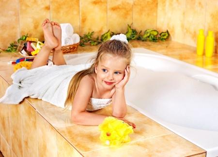 Little girl relaxing in bubble bath . photo