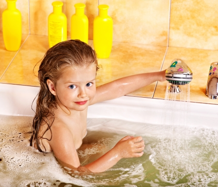 bubble bath: Happy child bathing in bubble bath .
