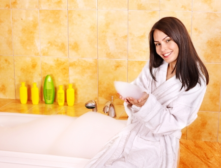 Young woman take bubble  bath  photo