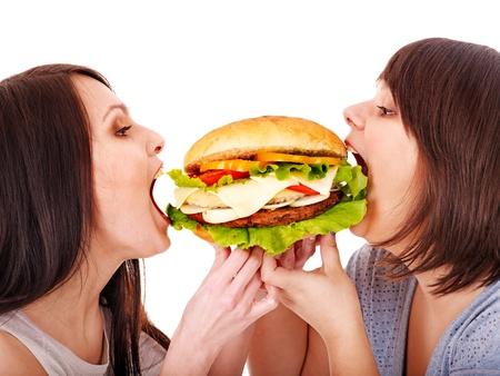 mujeres gordas: Las mujeres de comer hamburguesa. Aislado.