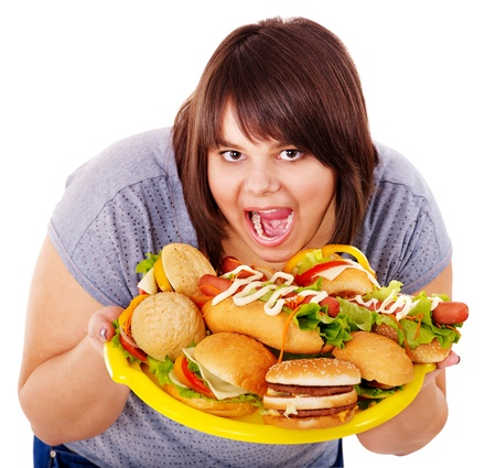 Overweight woman holding hamburger. Stock Photo - 14104622