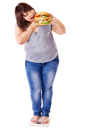 fat women: Woman weight loss on scales. Isolated. Stock Photo