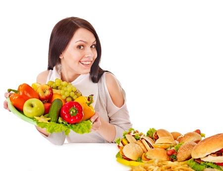Woman choosing between fruit and hamburger. Isolated. Stock Photo - 14104577