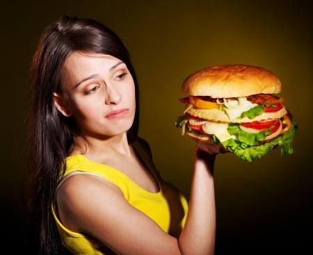 Slim woman holding hamburger. Stock Photo - 14092594