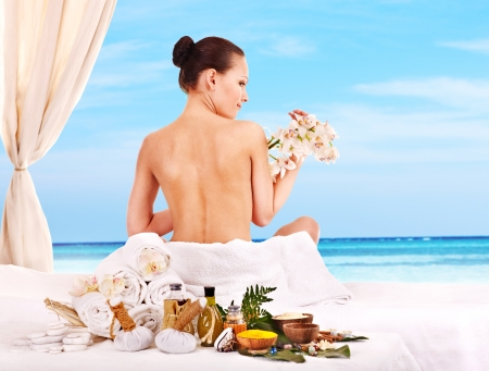 herbal massage ball: Young woman getting spa lastone therapy outdoor.