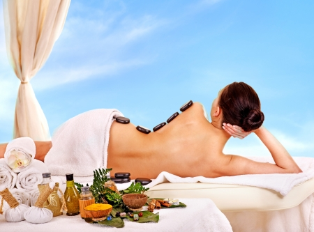 thai orchid: Young woman getting spa lastone therapy outdoor.