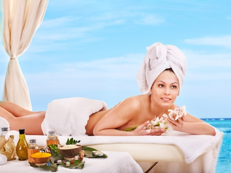 lastone: Young woman getting spa lastone therapy outdoor  Stock Photo