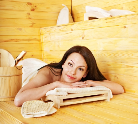 steam bath: Young woman in sauna. Stock Photo